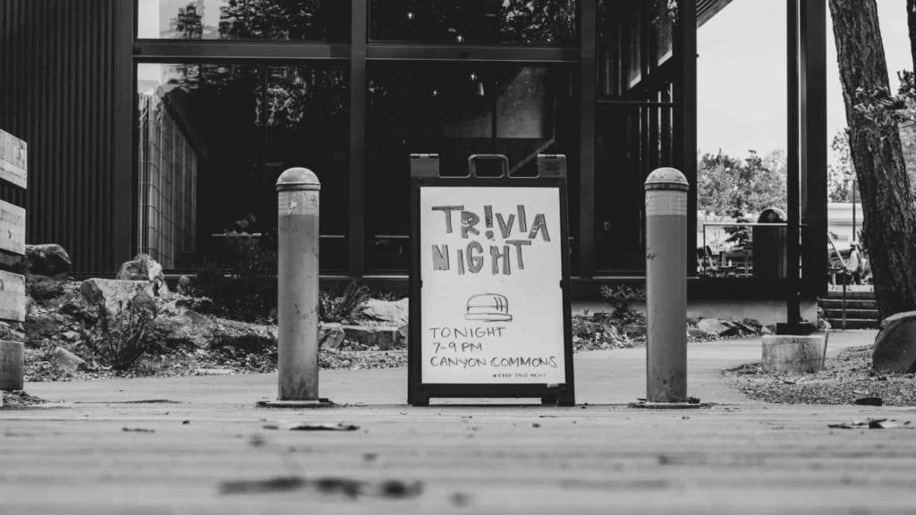grayscale photography of Trivia night signage